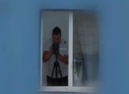 Man with zoom camera